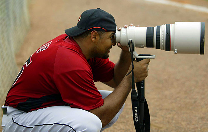 The Astros' new $100 million man, Carlos Lee, finds time for some amateur photography. Houston signed Lee away from the instate rival Rangers in the offseason for six years, $100 million.