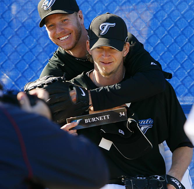Aces high: Roy Halladay (left) and A.J. Burnett clown around while posing for pictures.