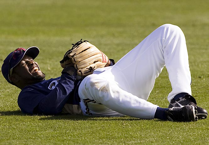Is he having a laugh? Outfielder Tony Gwynn falls to the ground after nearly being hit by a line drive.