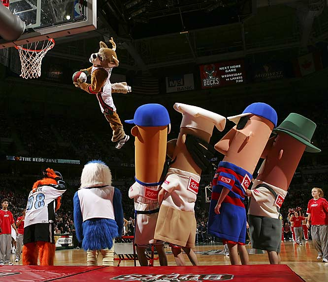 The sausages take in some mascot action at the Bulls-Bucks hoops game back home.