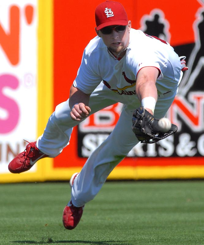 Chris Duncan dives for a fly ball in a game against the Astros.