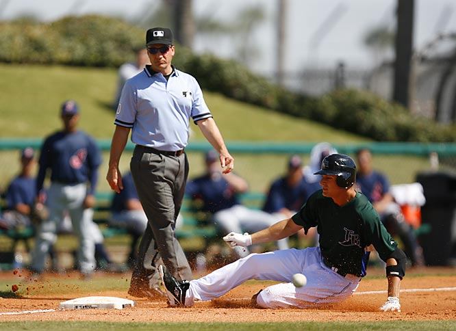 Rocco Baldelli slides safely into third with a triple against the Tribe.