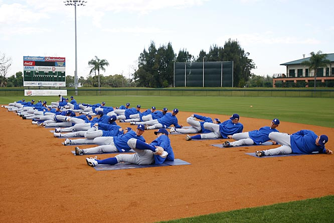 Players get loose before another day of workouts.