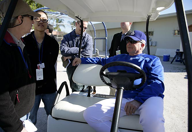 Manager Grady Little stops his golf cart to chat with some media.