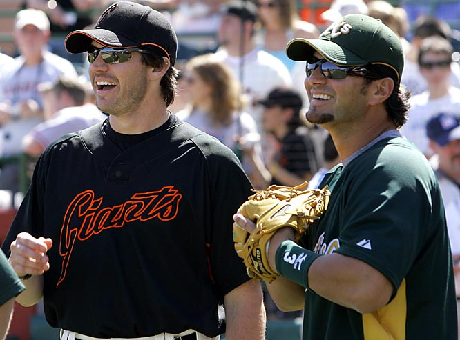 Zito chats with one of his former teammates on the A's, Eric Chavez.