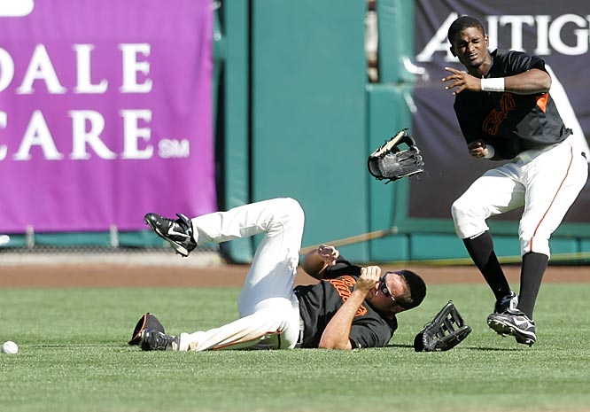 Nate Schierholtz, left, and Eugenio Velez collide while trying to catch a fly ball.