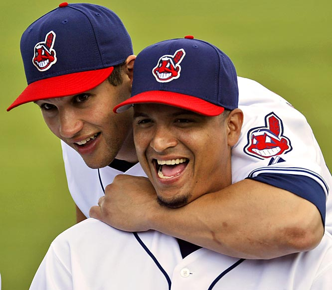Cleveland Indians' Grady Sizemore, left, jokes with teammate Victor Martinez while posing during picture day.