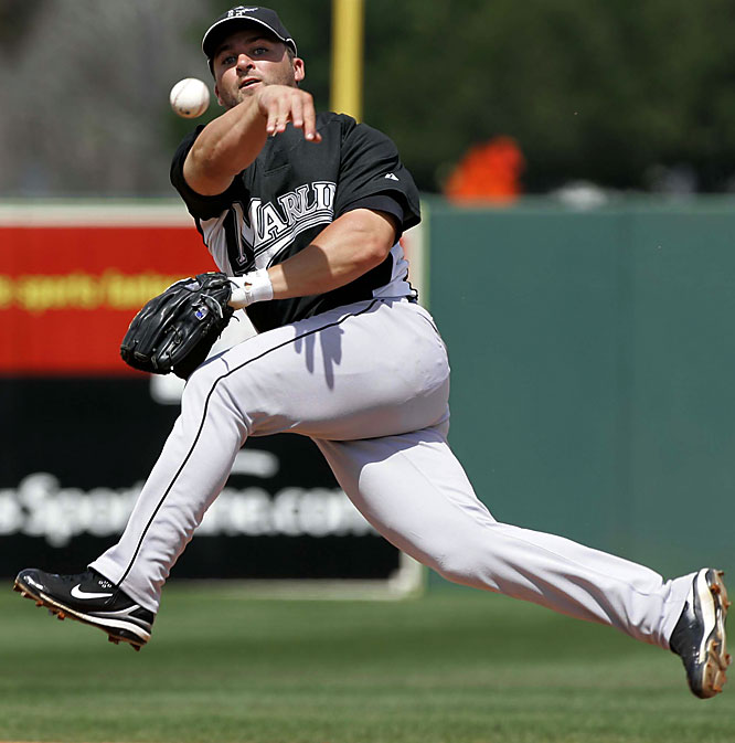 Second baseman Dan Uggla makes a tough play.