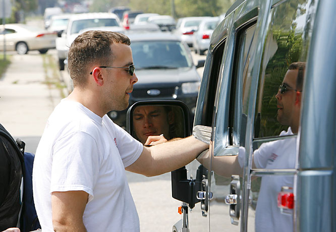 A fan gets Arroyo to stop his hummer and sign an autograph outside the team's training facility.