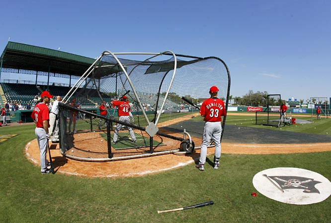 Outfielders Bubba Crosby, left, and Josh Hamilton watch Mark Bellhorn take batting practice before a game against the Pirates at McKechnie Field.