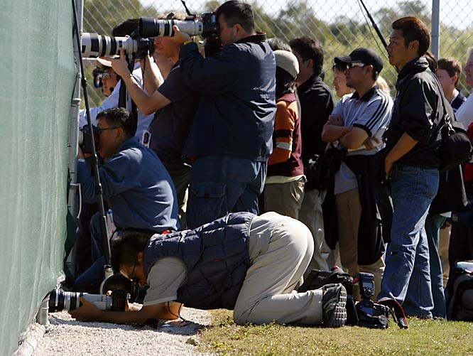 Any which way you can: One photographer gets creative in trying to get a shot of Daisuke Matsuzaka.