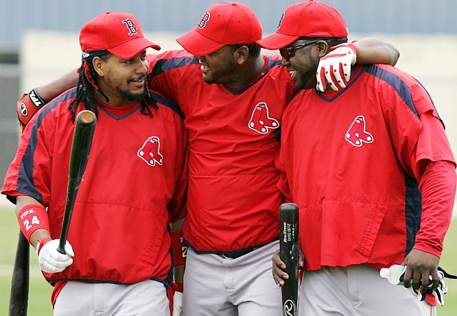 Together again: The late-arriving Manny Ramirez, left, with Wily Mo Pena and David Ortiz, right.