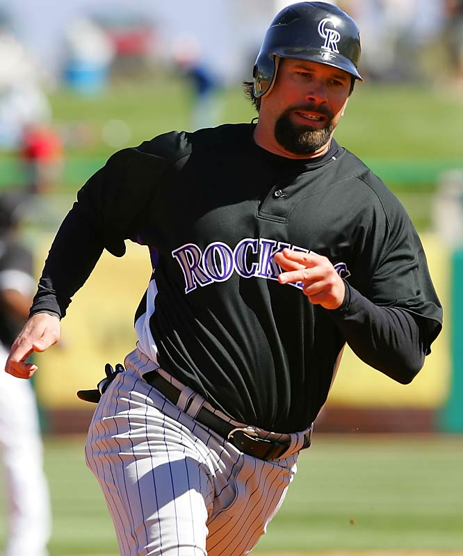 Todd Helton sports a thick mustache and goatee to go with his added muscle this season.