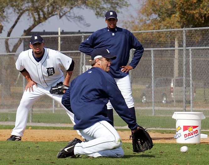 Tigers pitchers knew they would get a full dose of this early in the spring: infield practice. Kenny Rogers takes a ground ball as reliever Joel Zumaya looks on at the Tigers' spring facility in Lakeland, Fla.