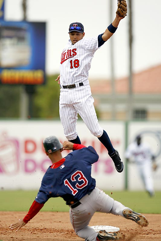 Shortstop Jason Bartlett goes vertical to grab this errant throw.