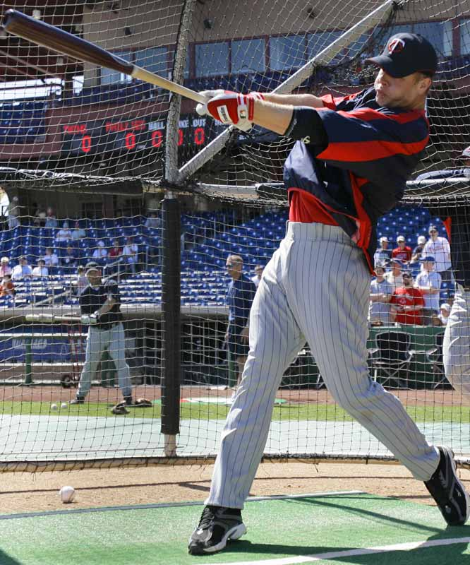 AL MVP Justin Morneau takes batting practice before a Twins-Phillies spring game on March 25.