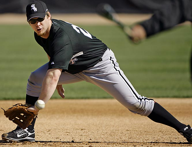 Third baseman Joe Crede plays the ball during fielding drills.