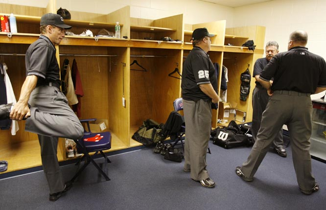 "Verducci stretches as the umpires get suited up in the clubhouse. ""I trained long (O.K., two days with Tschida and Culbreth) and hard (kicking back watching games in the Florida sun) for this gig,"" the author says."