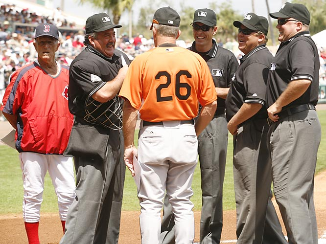 Verducci and the crew meet with Red Sox great Johnny Pesky, a special instructor, and Orioles coach Tom Trebblehorn at home plate before the game. As per custom, the rookie ump had his joke ready -- but Pesky wouldn't let him get a word in.