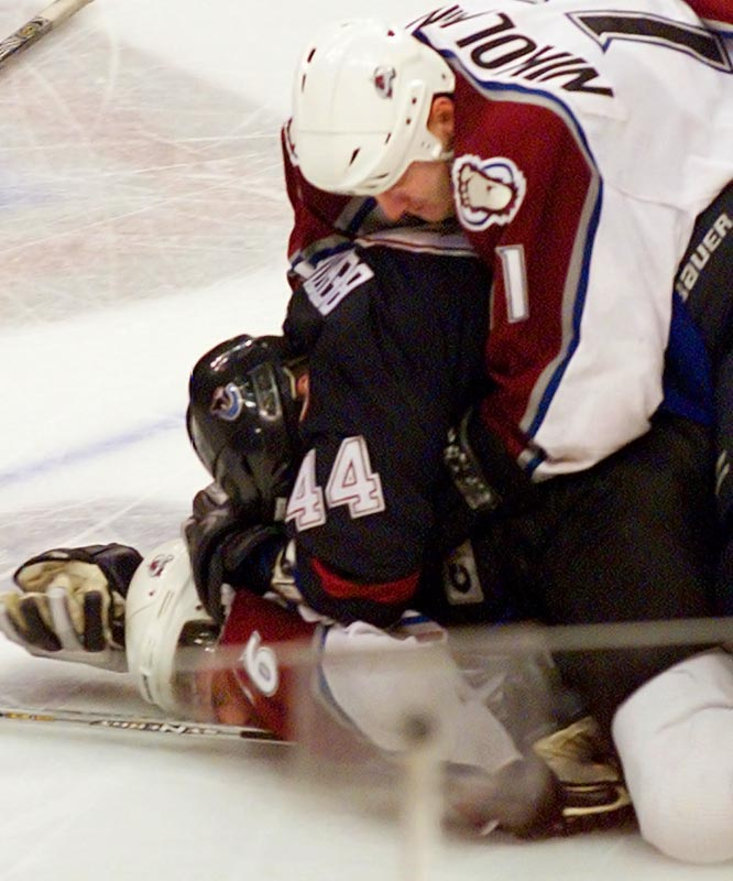 Bertuzzi's savage blow broke Moore's neck, ending the Avalanche rookie's career and igniting a firestorm of bad publicity for the NHL. Bertuzzi was suspended 17 months, banned from the 2004 World Cup of Hockey, world championships and all European pro leagues and sued by Moore. Bertuzzi eventually pled guilty to criminal charges.