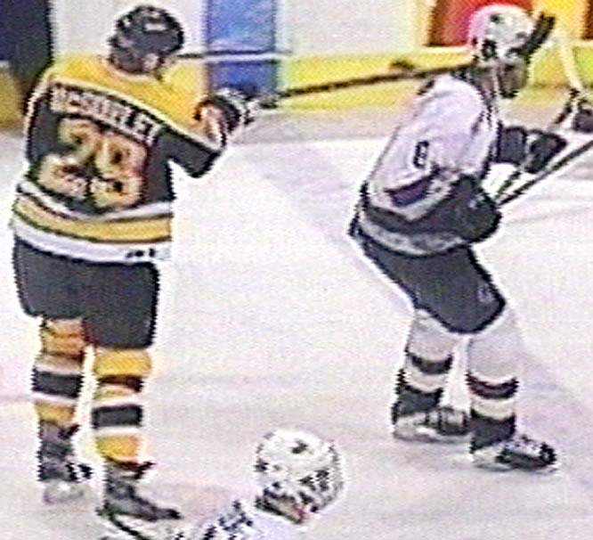 The Bruins' defenseman was suspended indefinitely and later found guilty of assault by a Canadian court for his two-fisted stick attack on the Canucks' Brashear with three seconds left in their game. Brashear's head hit the ice and he briefly lost consciousness, suffering a concussion and memory lapses.