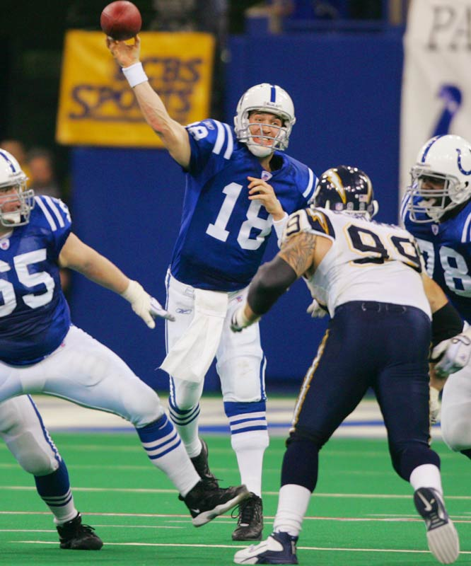 A raucous crowd in Indianapolis saw the Colts' QB break one of the NFL's greatest marks: the single-season record of 48 touchdown passes set in 1984 by his boyhood idol, Dan Marino.