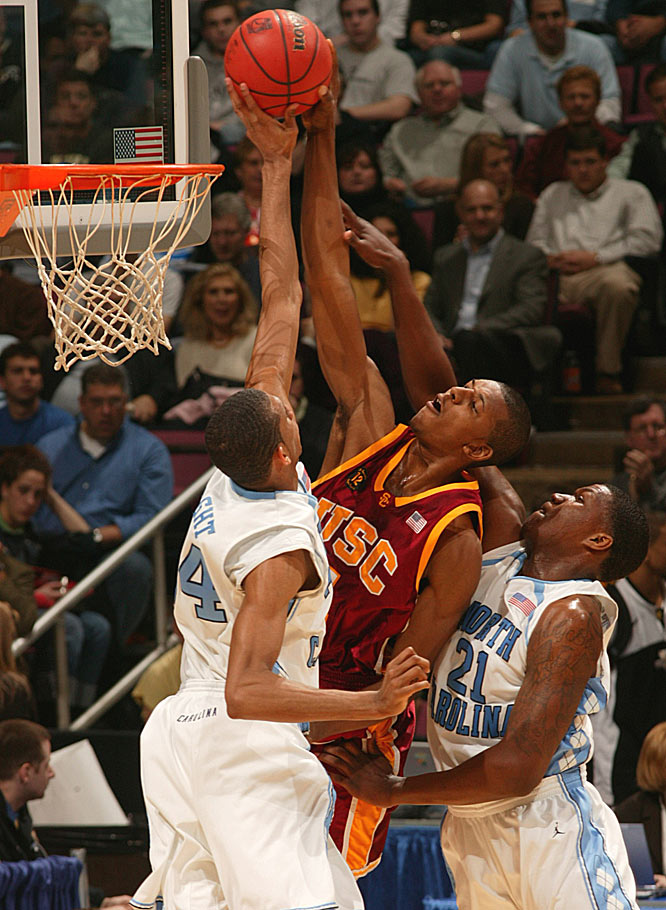 USC's Nick Young fights for the ball against North Carolina's Brandan Wright and Deon Thompson.