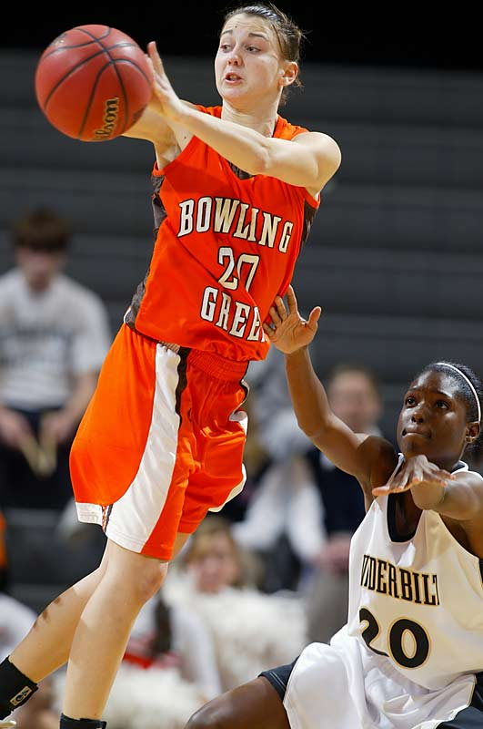 Bowling Green's Kate Achter just avoids a steal from Vanderbilt's Jessica Mooney in the Falcons' 59-56 victory over the Commodores. The win advanced Vandy to the Sweet 16.