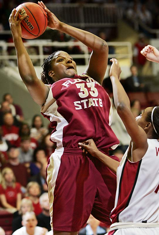 Florida State center Britany Miller rips down a rebound as Stanford guard Candice Wiggins looks on. The Seminoles defeated the Cardinal, 68-61, to advance to the Sweet 16.