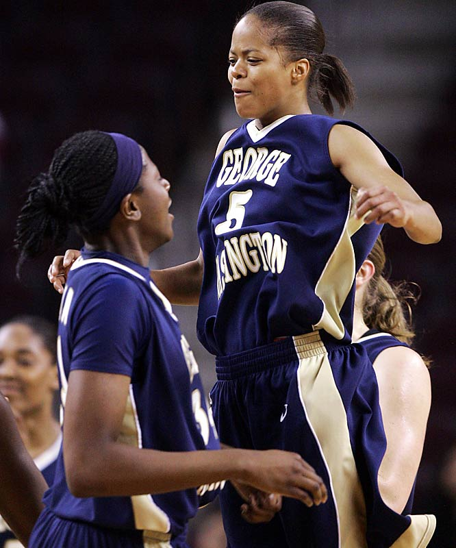 George Washington's Kimberly Beck celebrates with Ivy Abiona after defeating Texas A&M, 59-47, to advance to the Sweet 16.