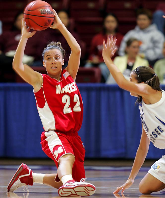 Marist's Nikki Flores and Middle Tennessee's Jackie Pickel takes the action to the floor in the Red Foxes second round victory over the Blue Raiders.
