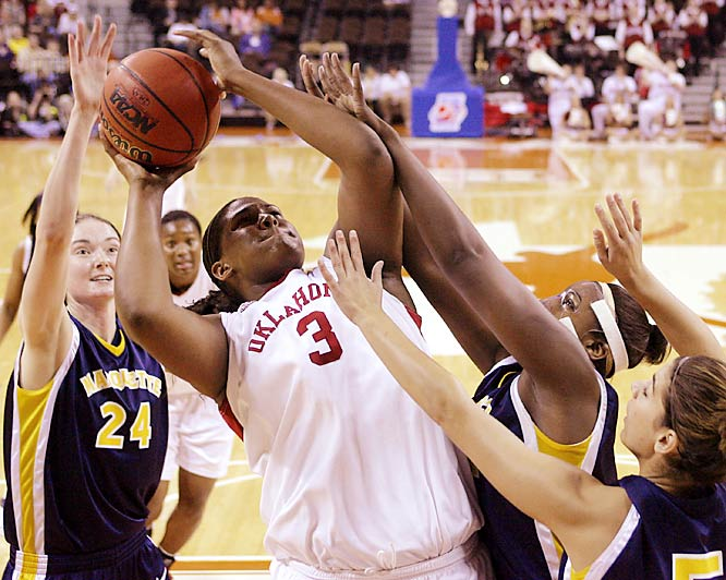 Three Marquette defenders can't stop Oklahoma's Courtney Paris during second round action on Monday. The Sooners manhandled the Golden Eagles, 78-47, to advance to the Sweet 16.