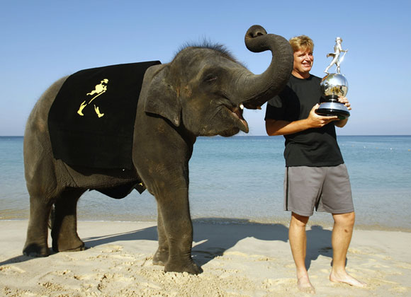 The PGA has decided to spice up its prizes. Not only can Ernie Els win the trophy he's holding at this weekend's Johnnie Walker classic, he can win the elephant, too.