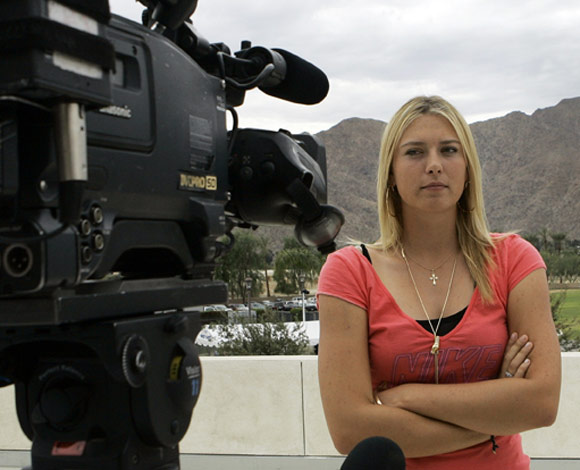 Maria Sharapova doesn't look too happy. Shouldn't she be used to cameras trying to get a shot of her?