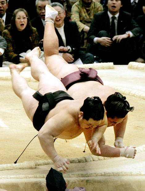 This is what happens when you tell two sumo wrestlers that it's first come, first served for lunch.