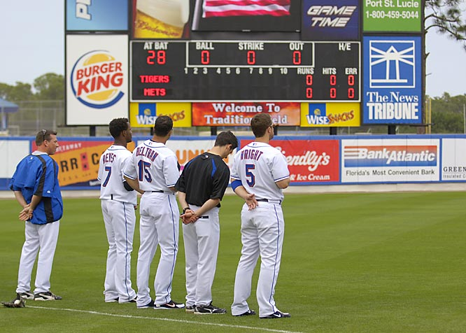 Players listen to the National Anthem before their first spring training game, Feb. 28 against Detroit.