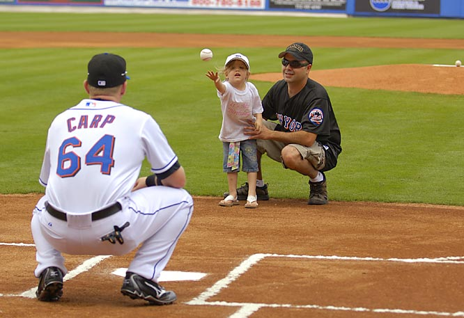 Mets' minor league player of the year Mike Carp catches the first pitch from a young fan on her birthday.