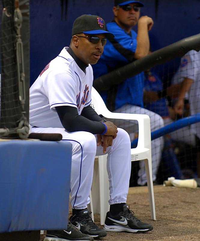 Manager Willie Randolph watches the game from a seat outside the dugout.