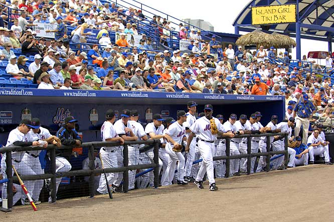 Carlos Delgado leads the Mets out of the dugout for the start of the game.