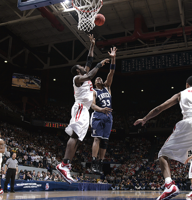 Ohio State's Greg Oden goes up to try and block Brandon Cole's shot during the first half.