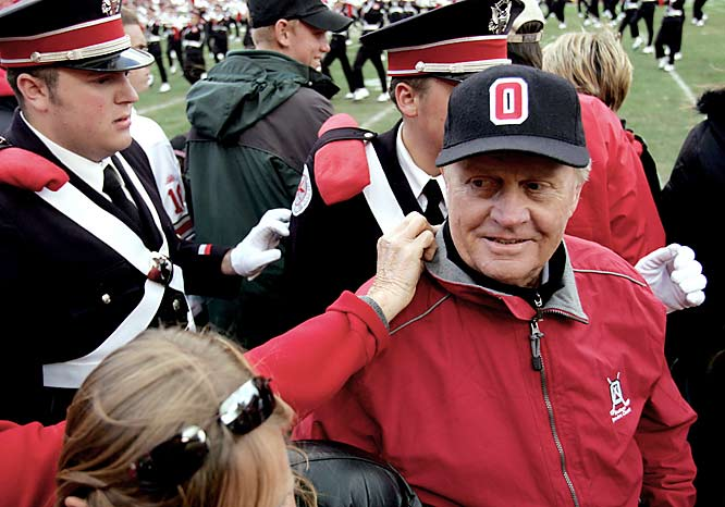 "Ohio State alumnus Jack Nicklaus is one of the few non-band members chosen to ""dot the i"" during a performance by the OSU Marching Band."