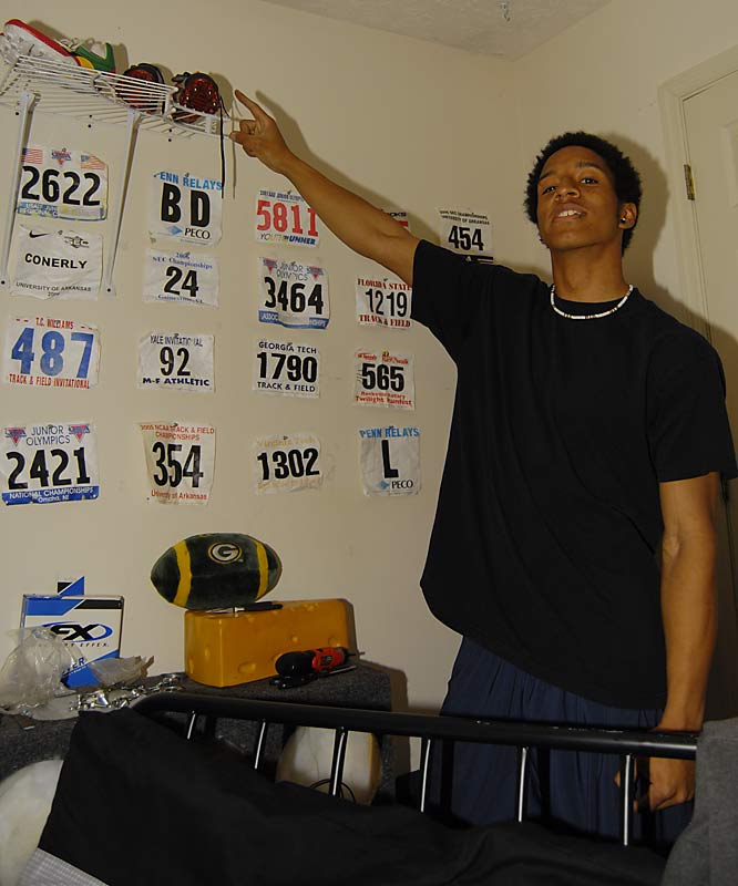 "On the other side of the duplex, Conerly stands in front of his collection of running bibs and points to his ""weapon of choice"" in his bedroom."