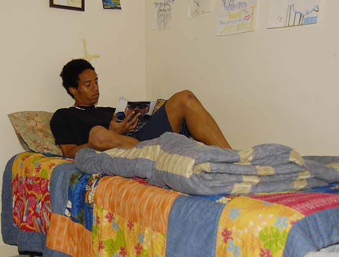 To relax, Conerly reads a Runners World magazine on his bed.