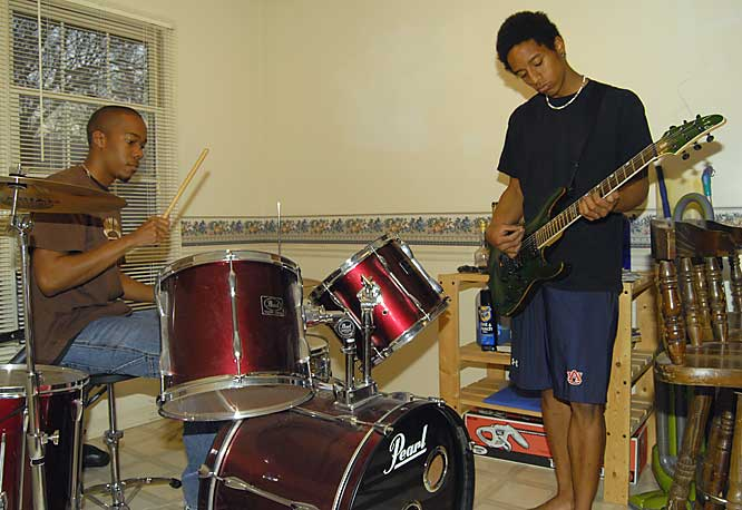 Conerly (guitar) and Stuckey (drums) jam out in the kitchen.