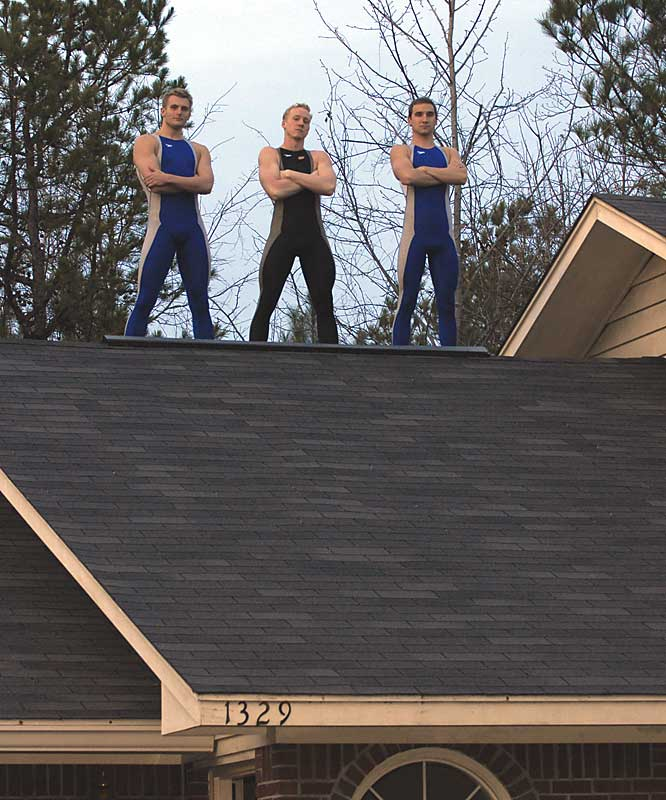 Weniger, Maras and  Smith stand on top of their roof, similar to how the Auburn men's swim team is on top of the SEC. The Tigers won their 11th consecutive conference championship this year.