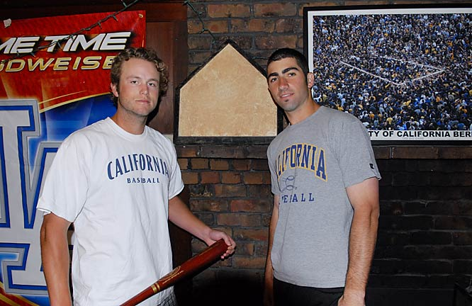 Stephen and Josh stand in front of a home plate sitting on their living room fireplace. As the story goes, an unnamed teammate was rushing a fraternity and in the process, dug up home plate from the baseball field of an unnamed Pac-10 school. What did he do with it? Brought it home for decoration of course.