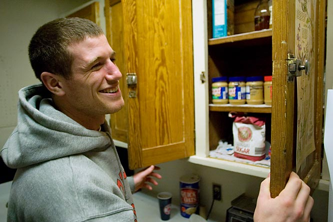 Co-captain Mitch Belisle surveys the almost-bare cupboards in the kitchen. What can you make from peanut butter and sugar?