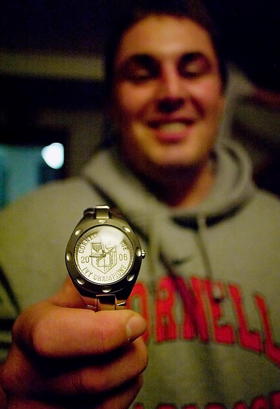 Seen here showing off his 2006 Ivy League championship watch, Randall is also the house champion of darts and Guitar Hero.