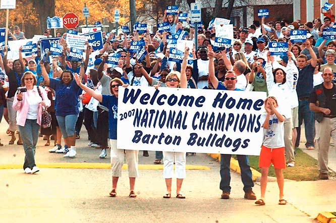 Fans greet the Barton team bus as it arrives on campus in Wilson, N.C., after winning the D-II men's title.
