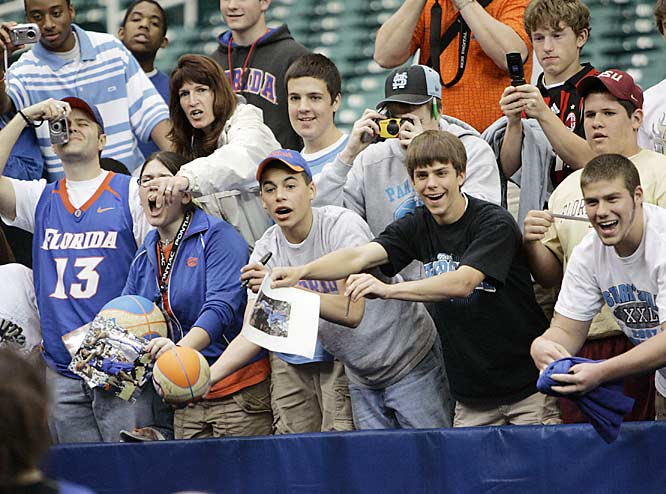 Florida fans seek autographs at the end of the Gators' practice session at the Georgia Dome on Friday.